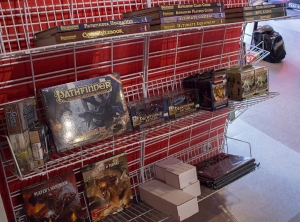 Storrs, Conn., Friendly Fire Game Center's Dun­geons and Drag­ons and other RPG selec­tion. Buck said the shelf was emp­tier than usual after a large pur­chase of D&D mate­ri­als. Photo/Nicholas Shigo