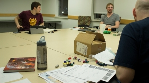 Mem­bers of the UConn Gamers' Guild plan their next move in a D&D cam­paign fraught with demons, pol­i­tics and real estate pur­chases. Photo/Nicholas Shigo